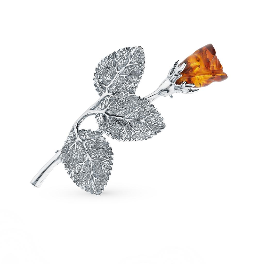 серебряная брошь с янтарем