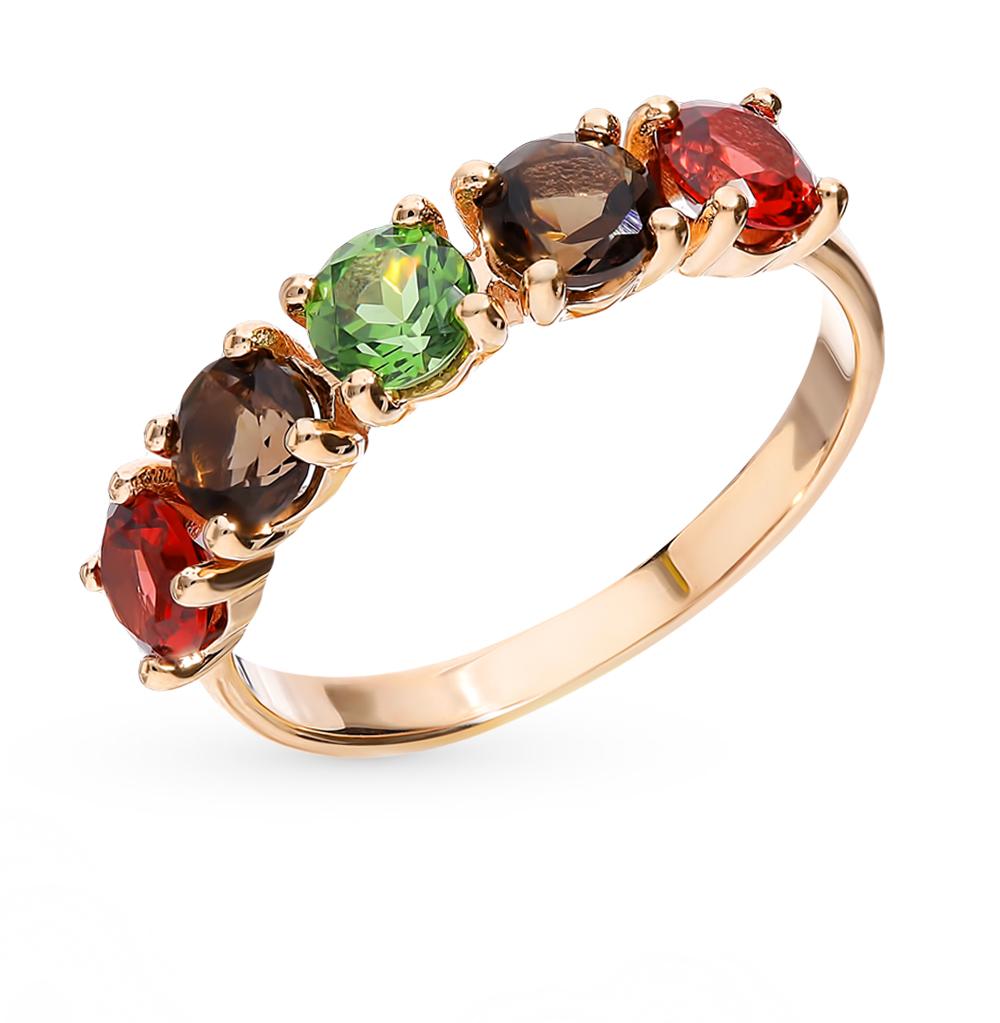 золотое кольцо с раухтопазами и гранатом