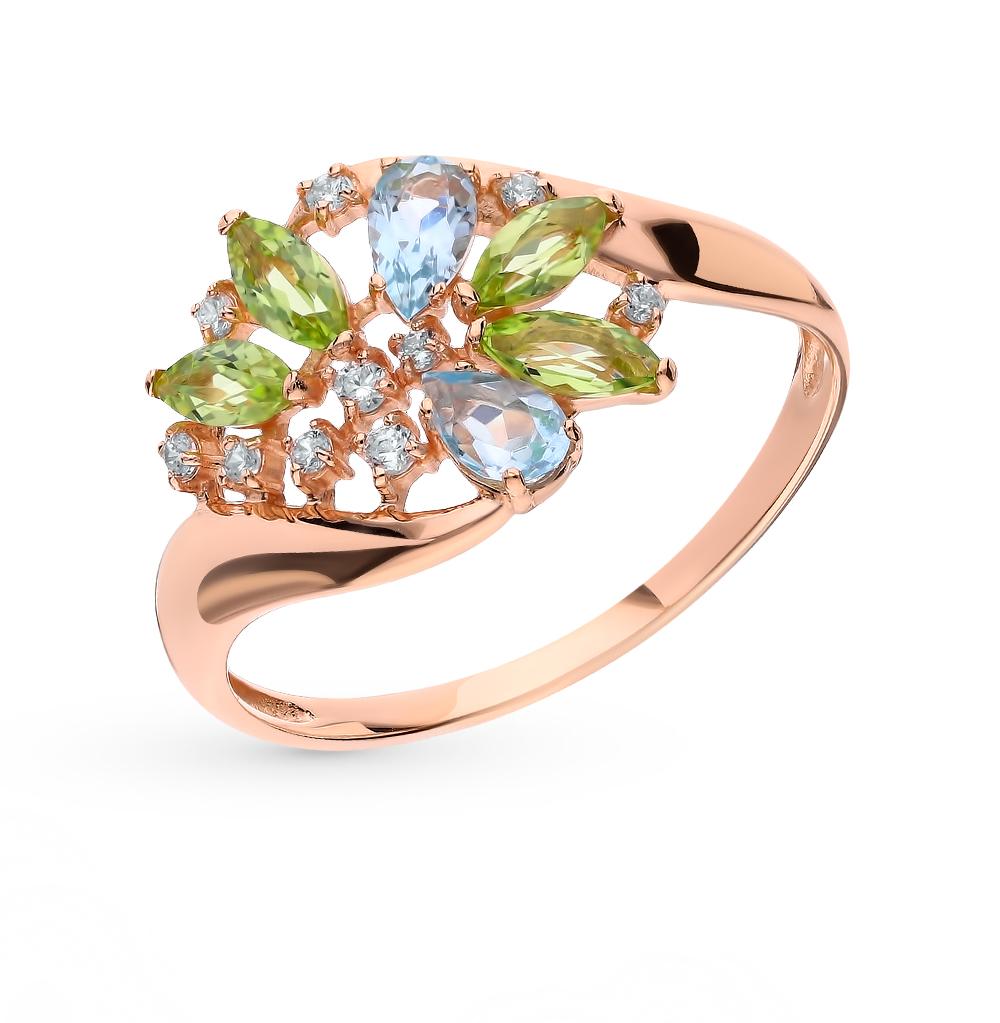 Фото «Золотое кольцо с хризолитом, топазами и фианитами»