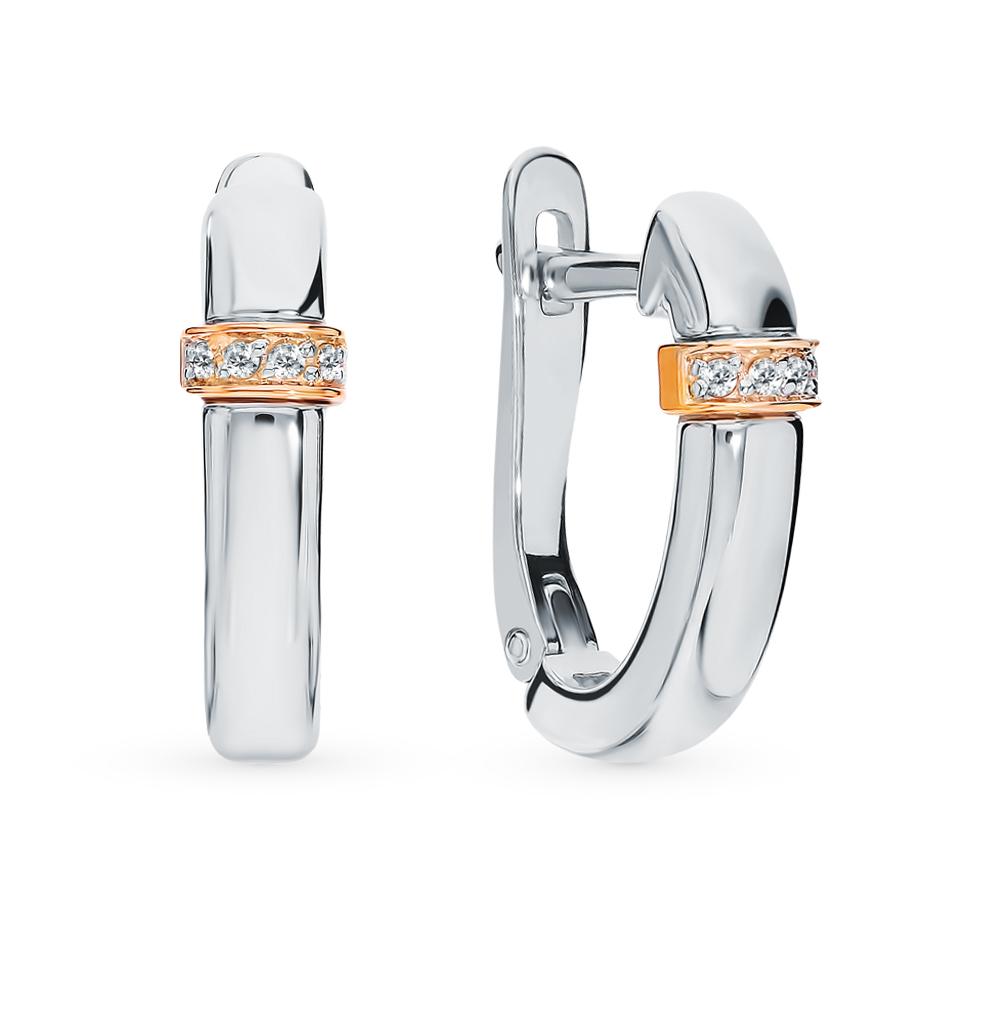 серебряные серьги с вставкой: золото и бриллиантами