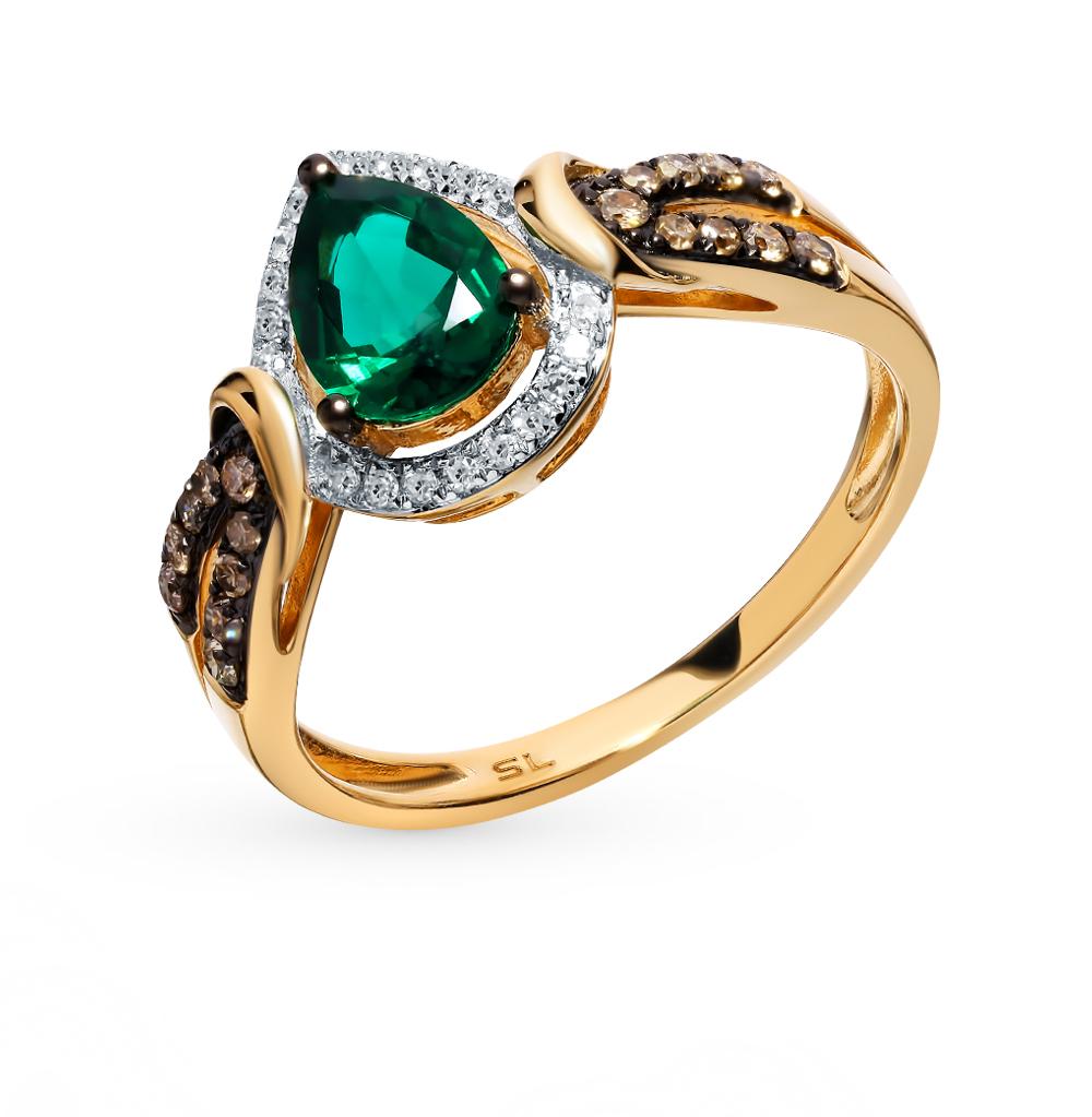 Фото «Золотое кольцо с коньячными бриллиантами и изумрудом»