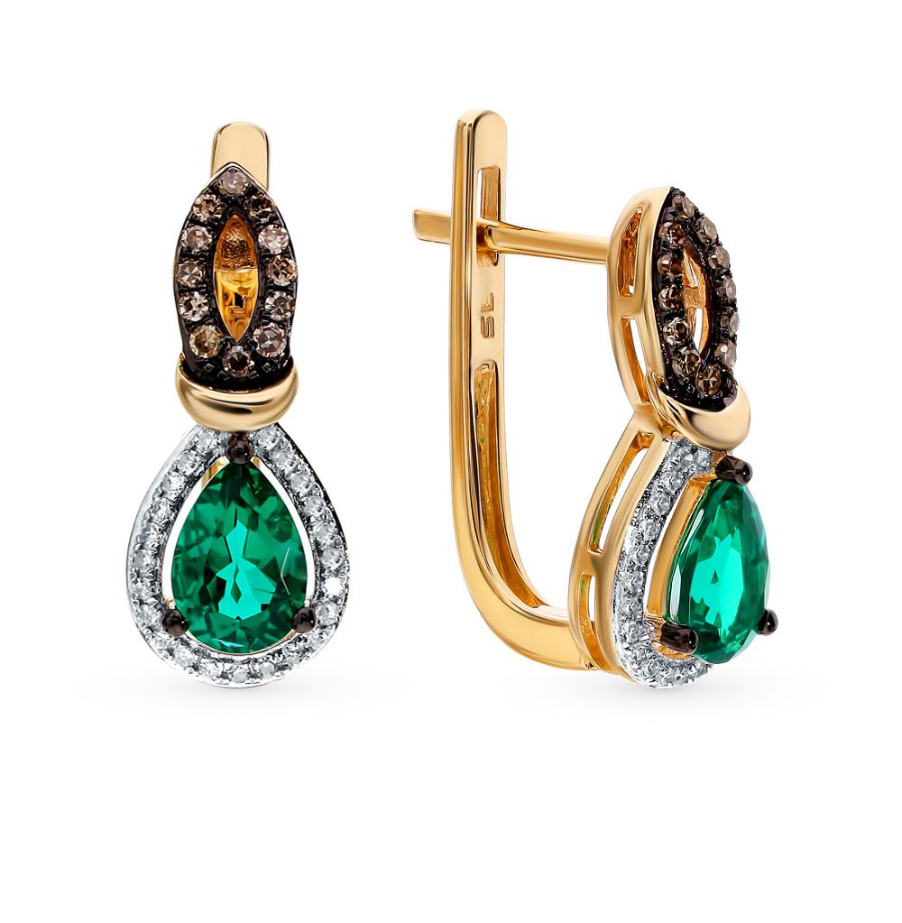 Золотые серьги с коньячными бриллиантами и изумрудами