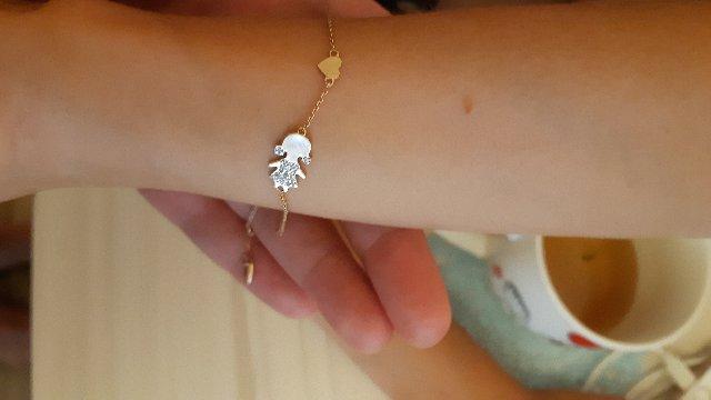 Браслет . Золотой с бриллиантами , в форме девочки.Имеет три разных крепежа