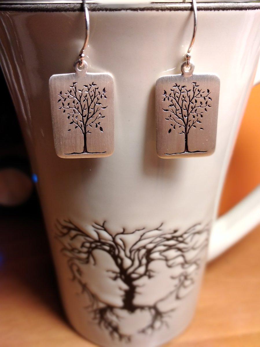 Серебряные серьги символы