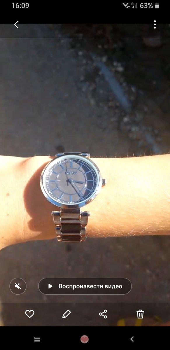 Эффектные часы с перламутровым циферблатом