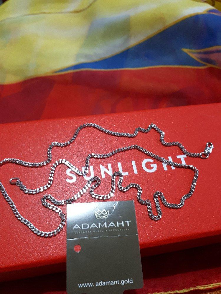 Серебряная цепочка панцирного плетения с алмазной гранью.