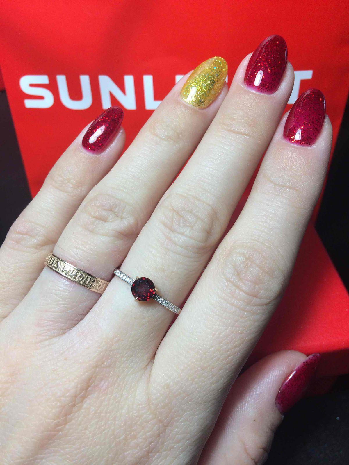 Золое кольцо с гранатом