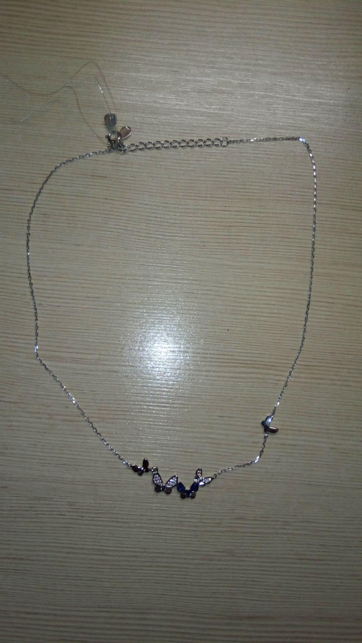 Серебрянное украшение на шею.