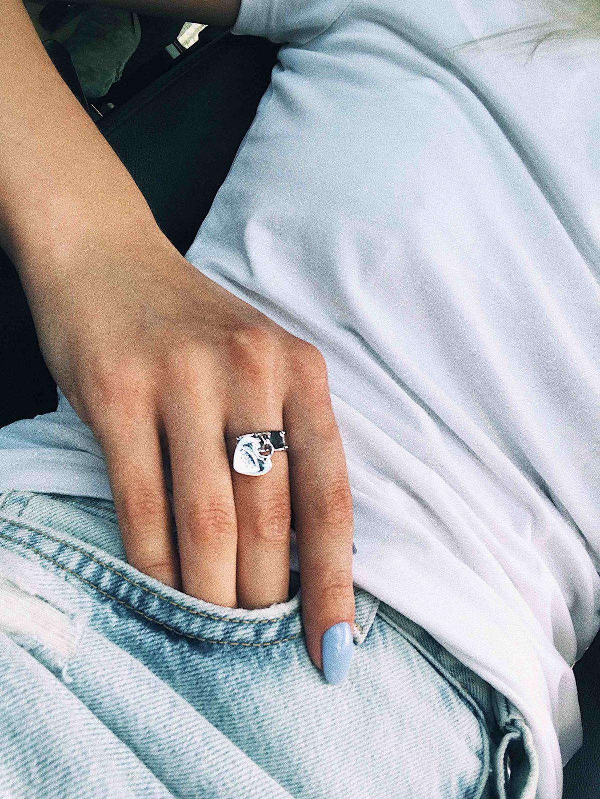 Серебряное кольцо с подвижным сердцем